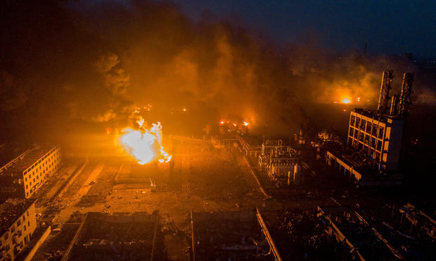 Smoke billows from fire following an explosion at the pesticide plant owned by Tianjiayi Chemical, in Xiangshui