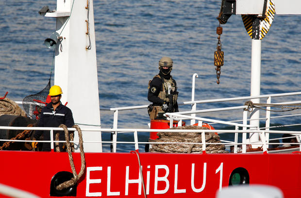 A Maltese special forces soldier is seen on the merchant ship Elhiblu 1 after it arrived in Senglea