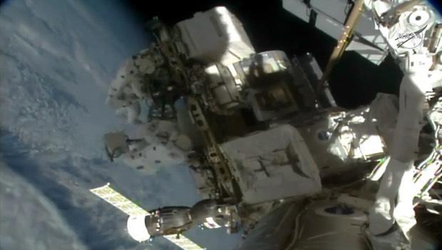 Spacewalking astronauts replace batteries at the ISS