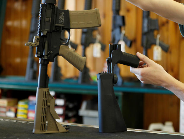 FILE PHOTO: A bump fire stock that attaches to a semi-automatic rifle to increase the firing rate is seen at Good Guys Gun Shop in Orem
