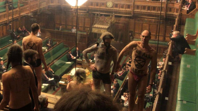 Extinction Rebellion activists strip in the House of Commons public gallery in London April 1, 2019, in this still image taken from social media video.