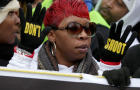 """Lesley McSpadden, mother of Michael Brown, helps lead the """"Justice For All"""" rally and march in the nation's capital against police brutality and the killing of unarmed black men by police Dec. 13, 2014, in Washington."""