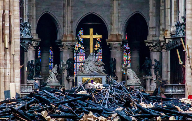 notre dame cathedral fire dozens investigating notre dame fire cause today live updates cbs. Black Bedroom Furniture Sets. Home Design Ideas