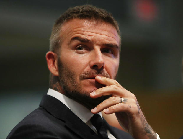 David Beckham banned from driving for six months for using mobile phone