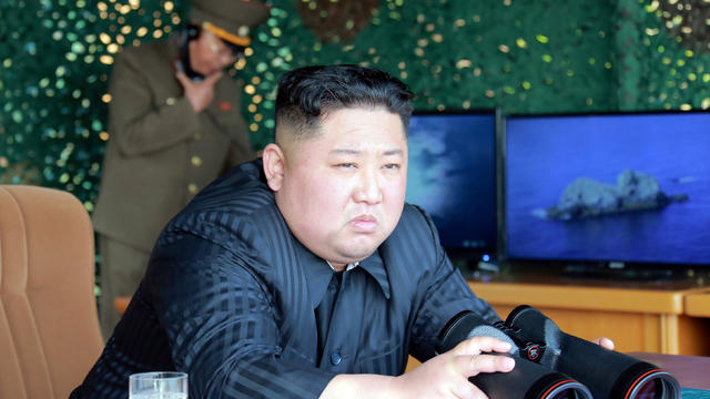 "North Korea's leader Kim Jong Un supervises a ""strike drill"" for multiple launchers and tactical guided weapon into the East Sea during a military drill in North Korea"