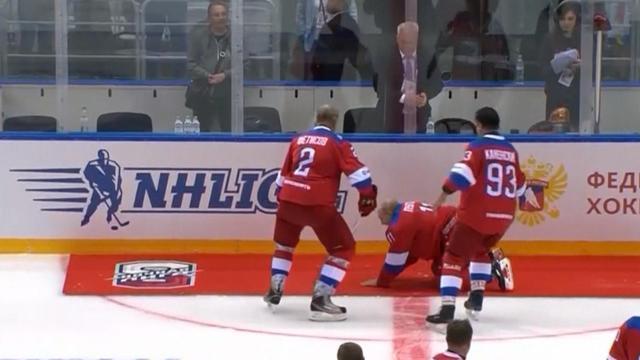 Russian President Putin Falls During Hockey Game Victory Lap Cbs News