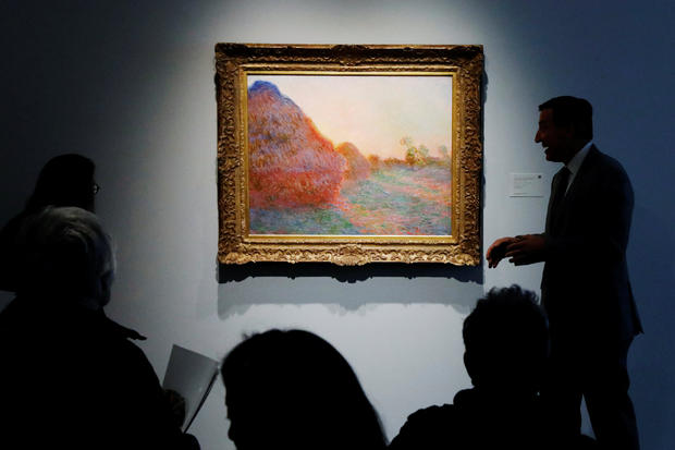 "Monet painting part of ""Les Meules"" is displayed at Sotheby's during a press preview of their upcoming impressionist and modern art sale in New York"