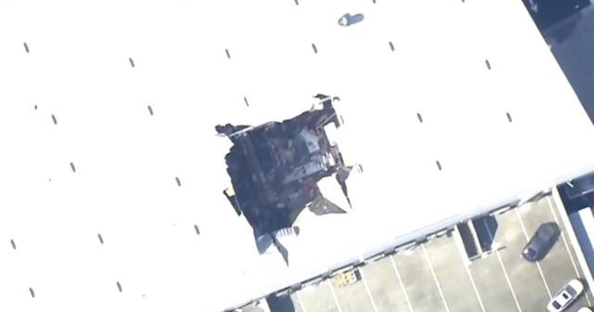 Fighter jet crashes into California building