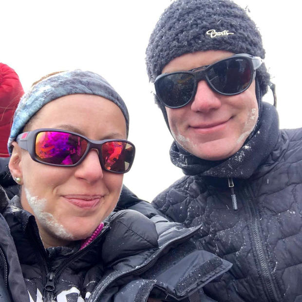 Robin Fisher and partner Kristyn Carriere take a selfie at Everest Base Camp