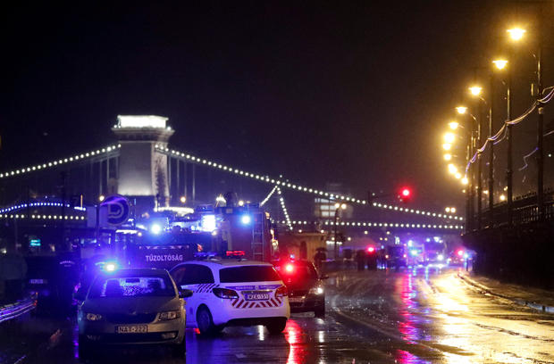 Police and four brigade vehicles seen on the Danube boat capsized on the river in Budapest