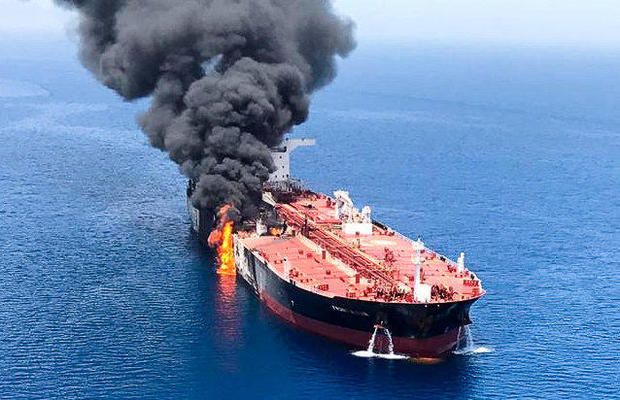 An oil tanker is seen after it was attacked at the Gulf of Oman