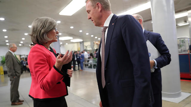 U.S. Senator Ernst speaks with acting Secretary of Defense Shanahan in the subway system at the U.S. Capitol in Washington