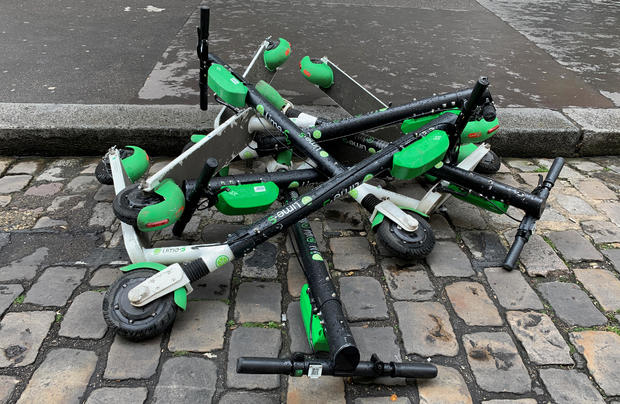 Dock-free electric scooters Lime-S by California-based bicycle sharing service Lime are stacked on Parisian cobblestones in a street of Paris
