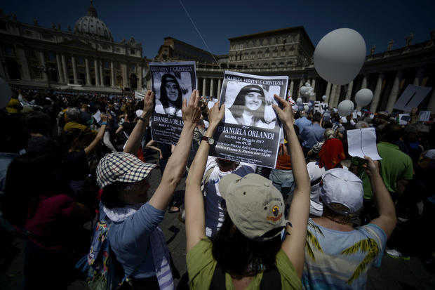 Demonstrators hold posters of Emanuela O