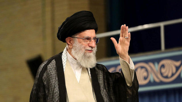 Iran's Supreme Leader Ayatollah Ali Khamenei waves during ceremony attended by Iranian clerics in Tehran