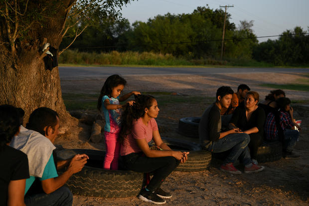 Central American asylum seekers turn themselves in to U.S. Border Patrol after illegally crossing the Rio Grande in Los Ebanos