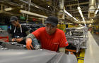 Line workers install the trunk on the flex line at Nissan Motor Co's automobile manufacturing plant in Smyrna Tennessee
