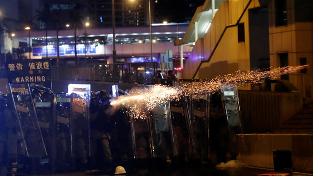 Riot police fire tear gas at demonstrators during a protest against police violence in Hong Kong