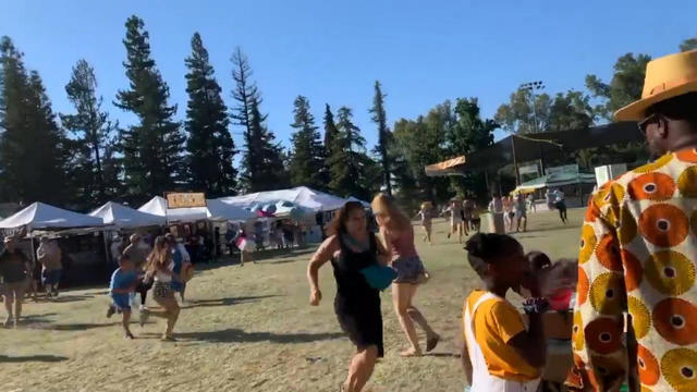 Social media video grab of people running away as an active shooter was reported at the Gilroy Garlic Festival, south of San Jose, California