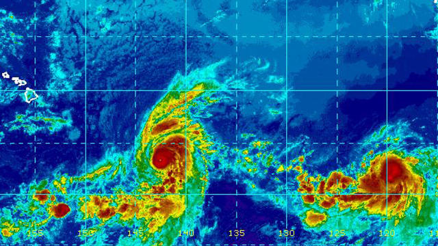 Hurricane Erick, center left, and Tropical Storm Flossie churn in the Pacific Ocean in an infrared satellite image captured at 9 a.m. ET on July 30, 2019.