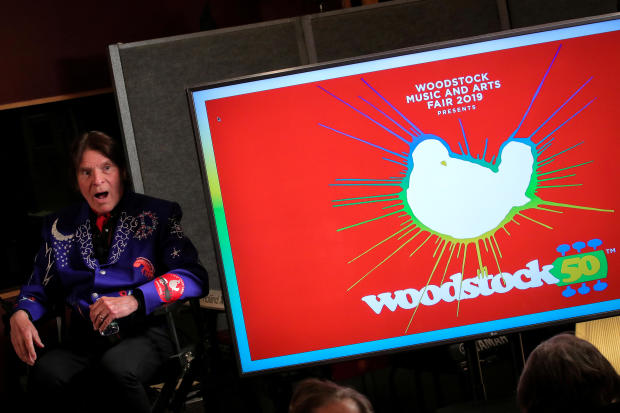 Singer John Fogerty speaks during the announcement event for the lineup for the Woodstock 50th anniversary concert in New York March 19, 2019.
