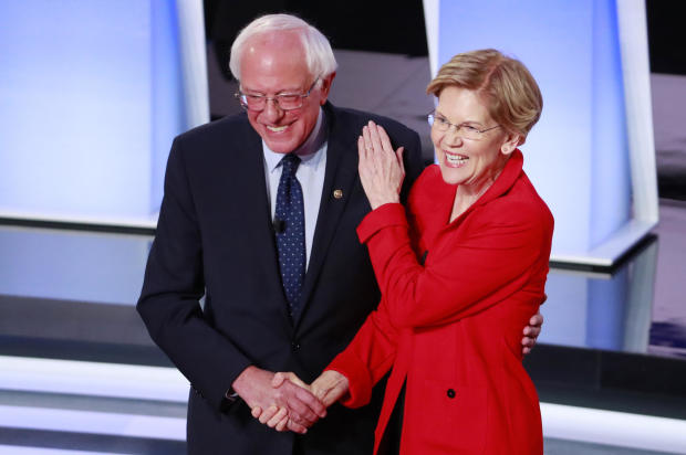 U.S. Senators Sanders and Warren shake hands before the start of the first night of the second 2020 Democratic U.S. presidential debate in Detroit, Michigan, U.S.