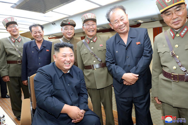 KCNA picture of North Korean leader Kim Jong Un guiding the test firing of a new weapon