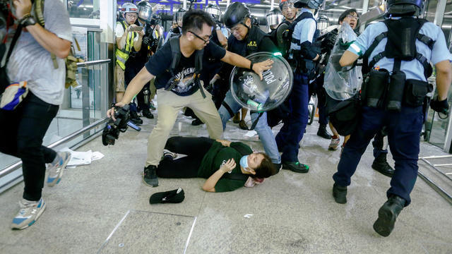 cbsn-fusion-hong-kong-protesters-fear-military-crackdown-after-violence-at-airport-demonstrations-thumbnail.jpg