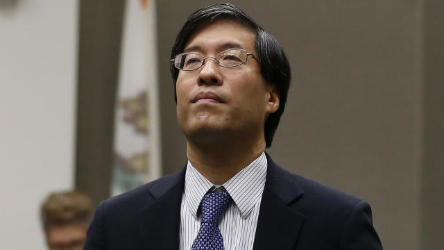 California state Senator Richard Pan, Democrat of Sacramento and a pediatrician, listens as members of the public called on lawmakers to reject his measure that would give public health officials oversight of doctors who may be giving fraudulent medical e