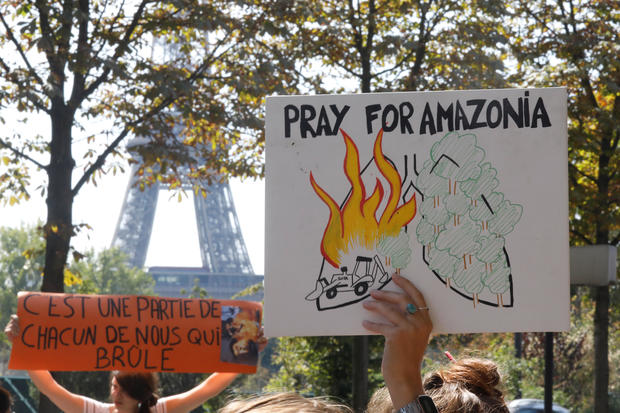 Youth for Climate demonstrators attend a protest outside the Brazil's embassy in Paris due the wildfires at Amazon rainforest