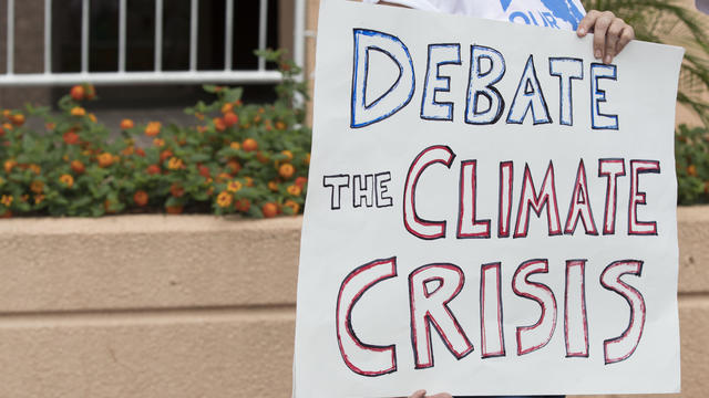 Greenpeace Protests Outside DNC Headquarters Urging The Party To Hold A Climate Change Debate