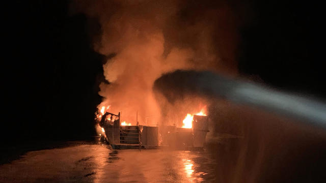 Firefighters battle a boat fire off the coast of Southern California September 2, 2019.