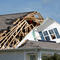 The roof of a home is ripped open by a tornado spawned by Hurricane Dorian in Carolina Shores, North Carolina