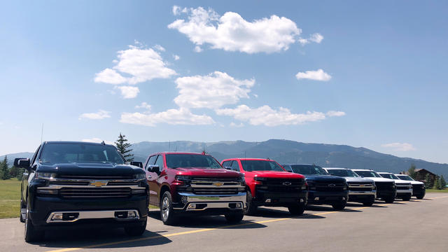 FILE PHOTO: Eight versions of General Motors CO's new generation Chevrolet Silverado pickups are pictured lined up at an event near Alpine