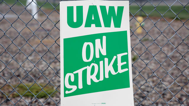 A United Auto Workers (UAW) picket sign is seen outside General Motors Powertrain Flint Engine plant during the UAW national strike in Flint