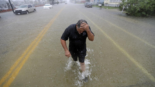 Angel Marshman wades through floodwaters from Tropical Depression Imelda after trying to start his flooded car September 18, 2019, in Galveston, Texas.