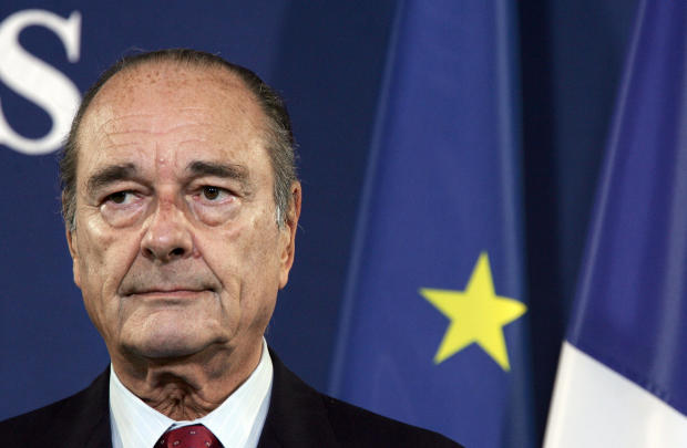 French President Jacques Chirac listens