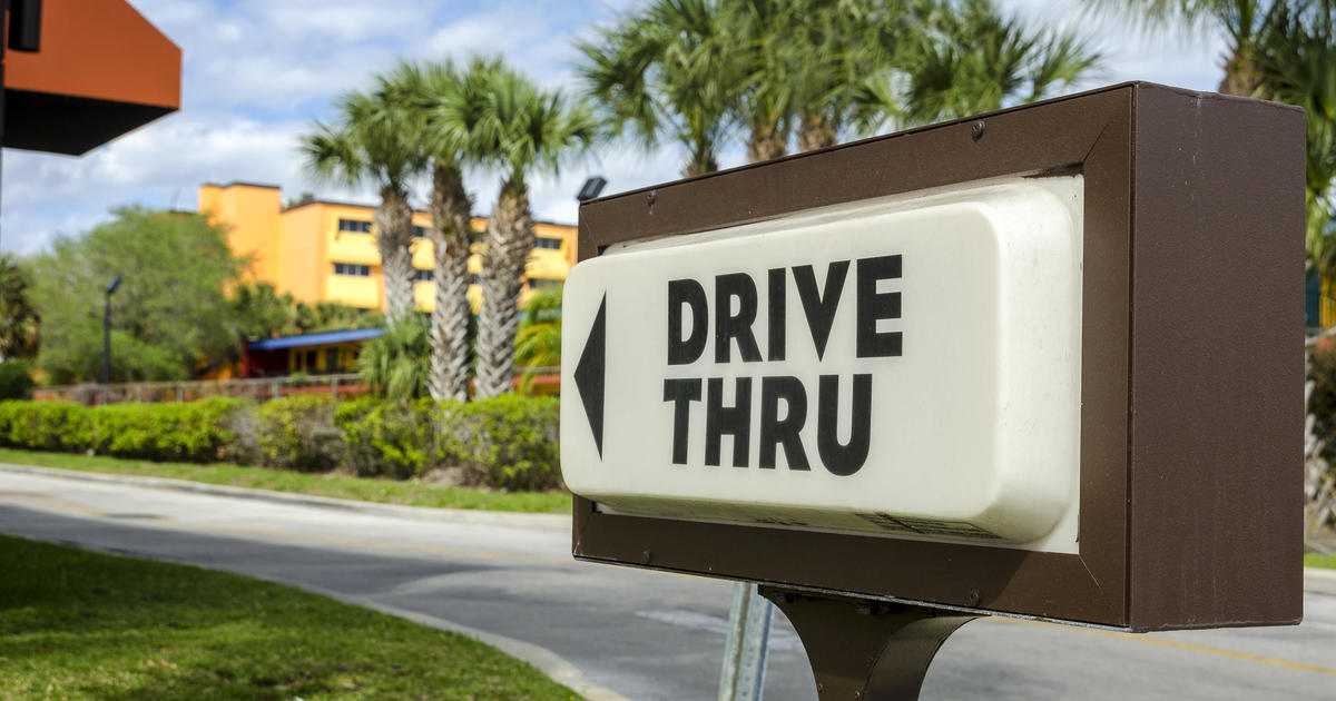 Moving to curb carbon emissions, cities put brakes on drive-thrus