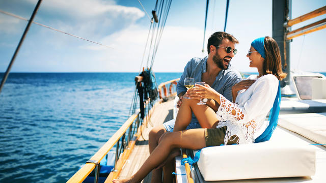 Couple on a sailboat.