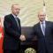 Russian President Vladimir Putin shakes hands with Turkish President Recep Tayyip Erdogan during their meeting in the Black sea resort of Sochi