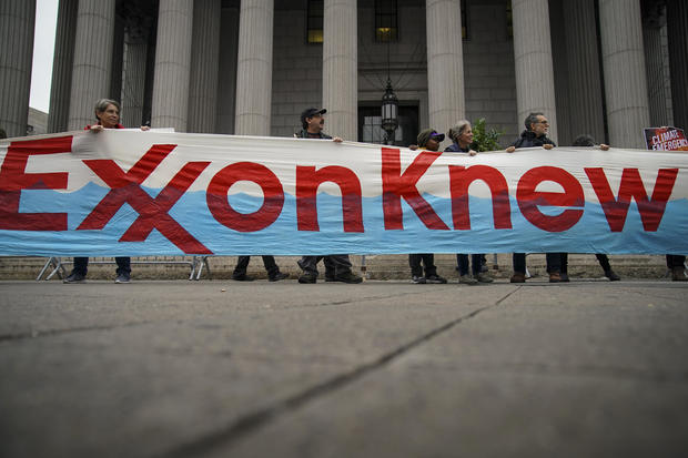 Environmental Activists Protest Outside Exxon Fraud Trial