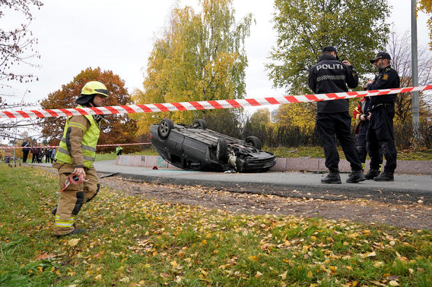 An overturn car is seen on the road, after it was allegedly struck by an ambulance which was stolen by an armed man in Oslo