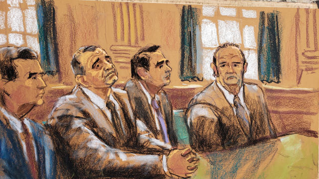 Ukrainian-American businessman Lev Parnas and Russian-born businessman Igor Fruman sit with their lawyers