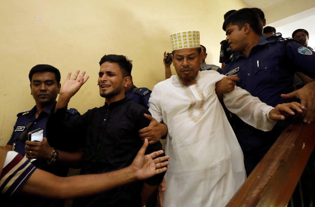 Accused people are taken out of the court premises after they were given death sentences in a murder case in Feni
