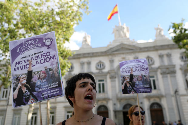 """Women gather outside the Supreme Court after Spain's top court found five men known as the """"Wolf Pack"""" guilty of rape in Madrid"""