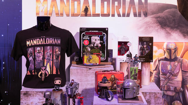 Merchandise from Star Wars: The Mandalorian, television series sit on display at the announcement of new Star Wars products at Pinewood Studios, Iver Heath