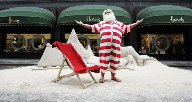 Man dressed as Father Christmas poses for photographers outside Harrods