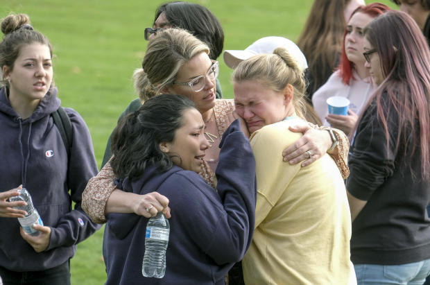 Students are comforted as they wait to be reunited with their parents following a shooting at Saugus High School November 14, 2019, in Santa Clarita, California.