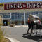 (js) bz03retail_bb_2 -- A shopper pushes a cart full of linens from bankrupt Linens-N-Things in Bel Mar Wednesday. The retaler is closing four Denver area stores, including one in the Bel Mar development. They are selling out he inventory and store fixtur