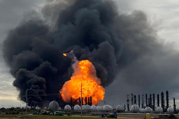 FILE PHOTO: A process tower flies through air after exploding at the TPC Group Petrochemical Plant in Port Neches